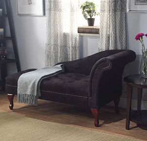 Black microfiber chaise lounge used as window seat