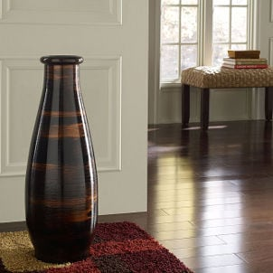Brown floor vase complements hardwood floor