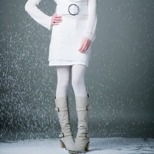 Woman wearing a white sweater dress in winter