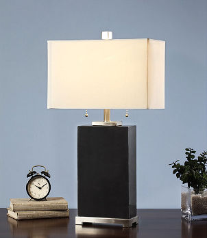 Black contemporary lamp with cream-colored lamp shade