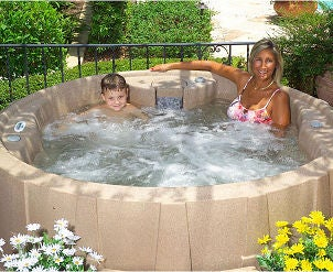 Mother and son enjoying a hot tub