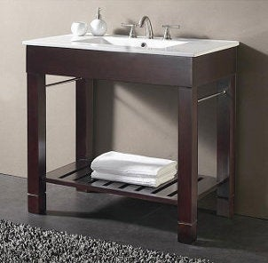 Small espresso and white bathroom vanity with silver faucet and handles