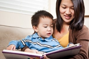 Mother and son reading a kids' book together