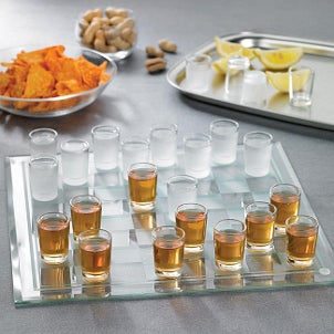 Shot glasses used as pieces on a checkers board