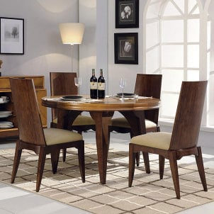 Round hardwood dining table with four chairs