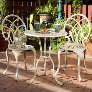 White aluminum bistro set on a patio