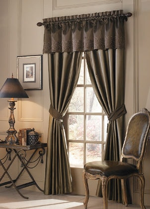 Dark green satin curtains complemented by satin valance