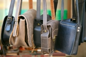 Leather and synthetic messenger bags