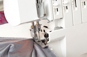 Overlock sewing machines have many controls to adjust tension and the number of threads
