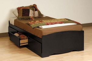 Kids storage bed with bedding and open drawer