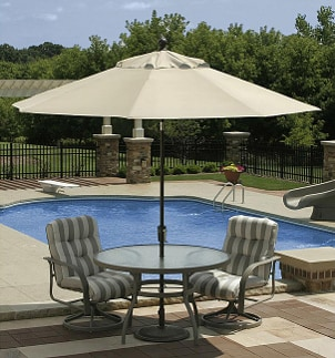 Beige patio umbrella shades patio table by the pool