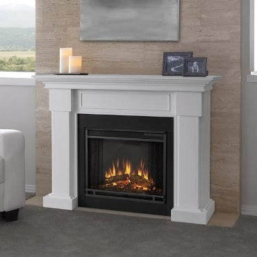 Electric fireplace set in white mantel
