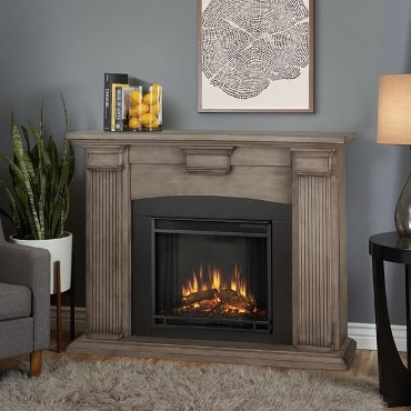 Electric fireplace and brownish-grey mantel