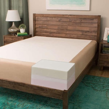 Wooden-framed bed with memory foam mattress