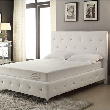 White bed with memory foam mattress and pillows