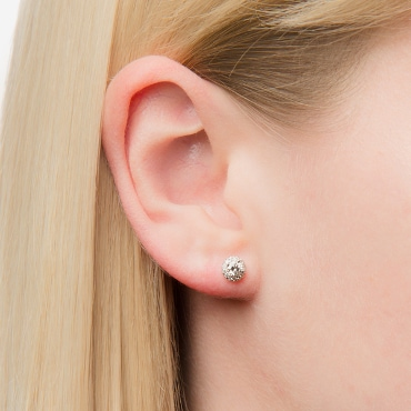 Close up of a woman's ear with a diamond stud