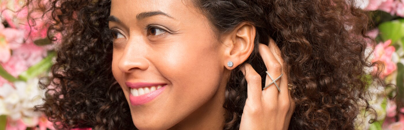 Woman wearing a diamond stud earring