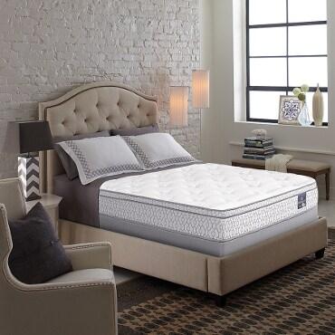 Multi-layered memory foam mattress on bed