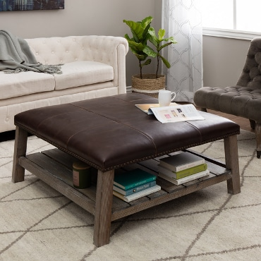 Square ottoman being used like a coffee table