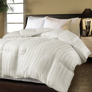 Striped, white comforter on bed