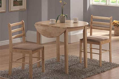 Small drop-leaf table with two chairs