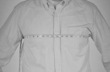 Front view of man's chest being measured