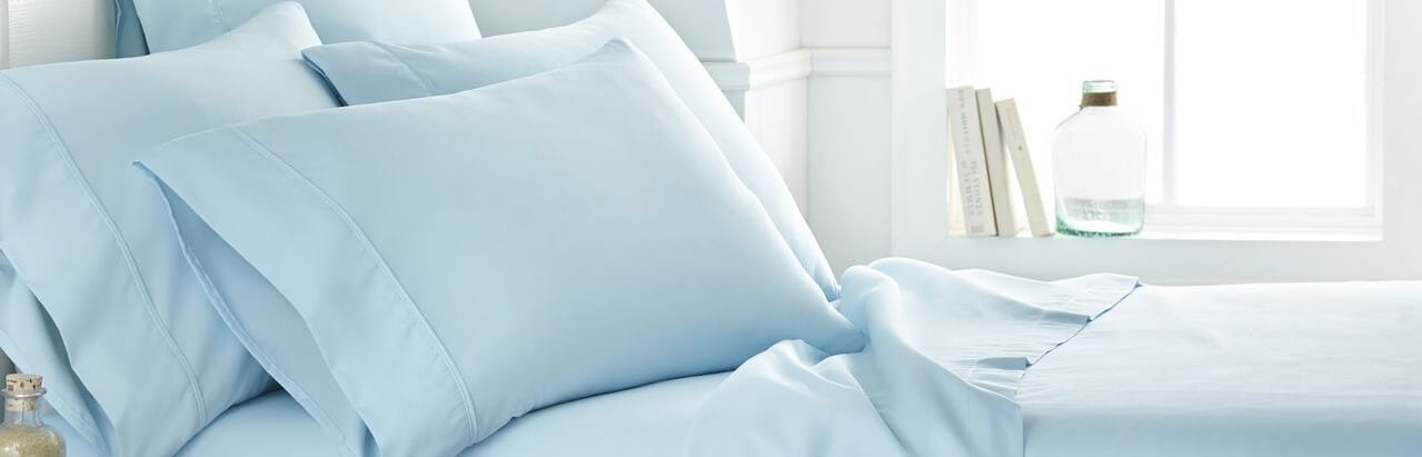 bed with light blue sheet set
