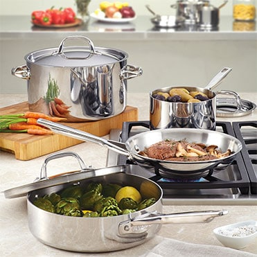 Stainless steel cookware on kitchen countertop and stovetop