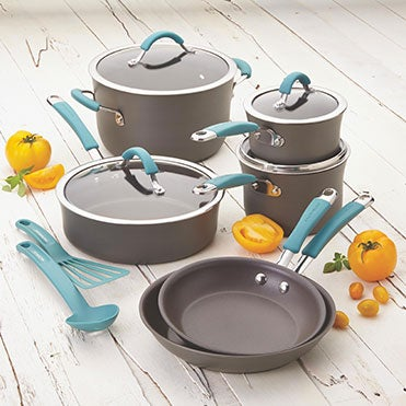 Nonstick cookware set sitting on a whitewashed table