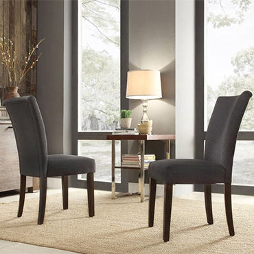 Two dark upholstered dining chairs.
