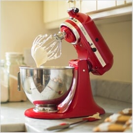 Red Kitchenaid mixer with batter
