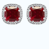 Cushion cut ruby earring in a halo setting