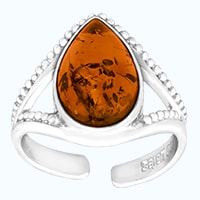 Pear shaped amber in stering silver ring