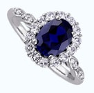 Oval cut blue sapphire in a halo setting
