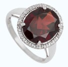 Oval garnet white gold ring