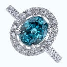 Oval blue zircon in halo white gold setting