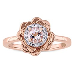 Rose gold ring with center morganite stone in a diamond halo flower setting