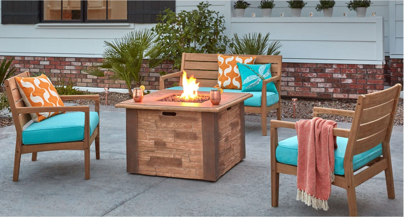 A backyard patio furniture set with a fire pit