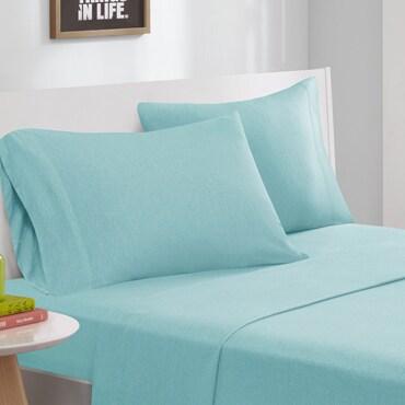 Aqua bed sheets on a bed