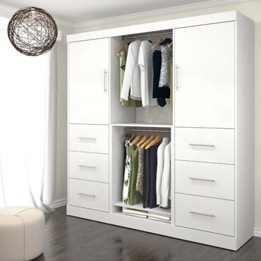 Armoire against wall with clothing