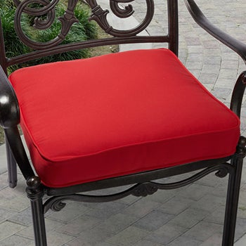 Outdoor dining chair with red chair cushion