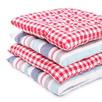 Stack of checked and striped chair cushions.