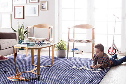 Living room with boy playing on floor