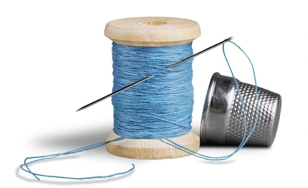 Image of needle, thread and thimble