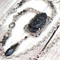 Sweet Romance Art Deco Hand Carved Buddha GuanYin Black and Silver Necklace