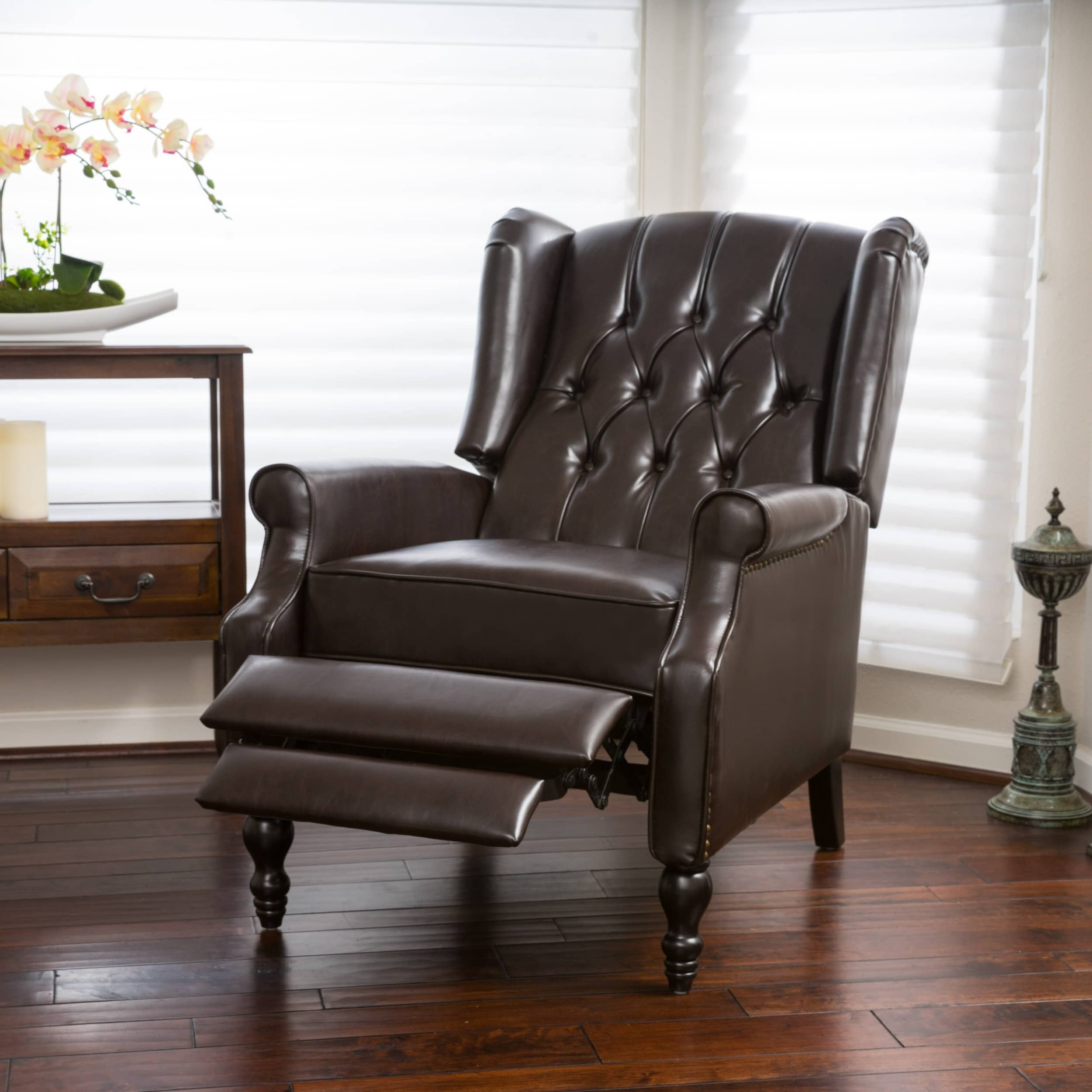 rocking neck bent leather sofas recliner high po armchairs gb brown products ikea chair for arm eggshell the support back black glose gives good ng en your