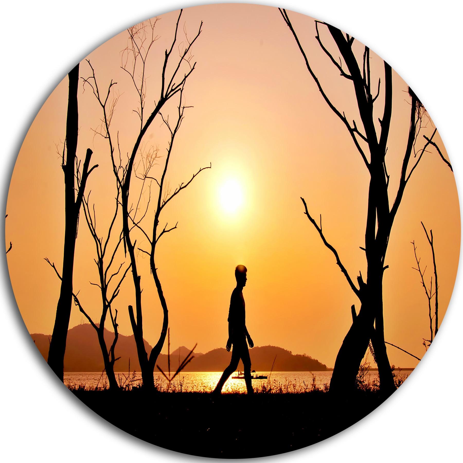 Designart \'Man Walking Alone in Evening\' Landscape Photo Round Metal ...