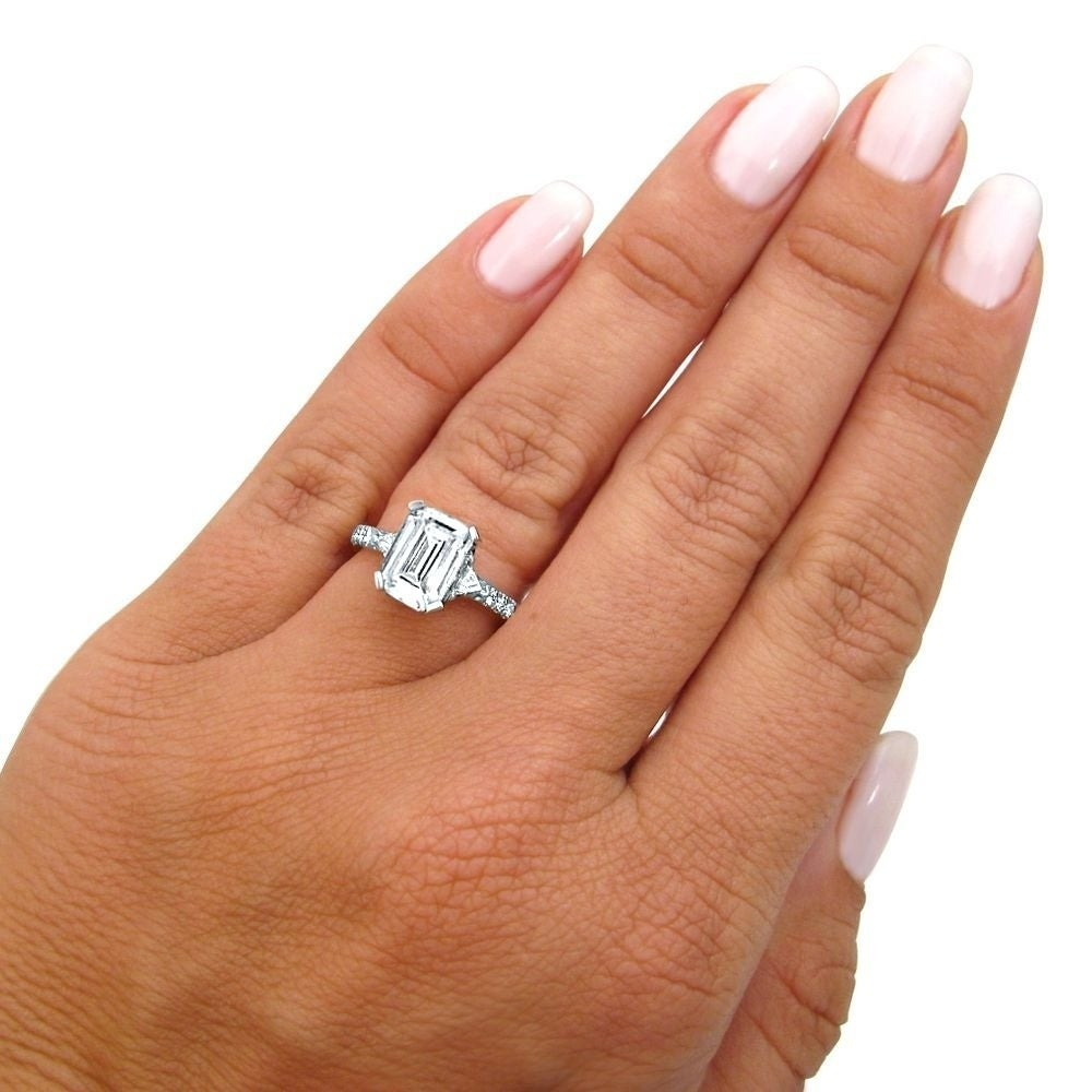 april rectangular cut by rings engagement designs