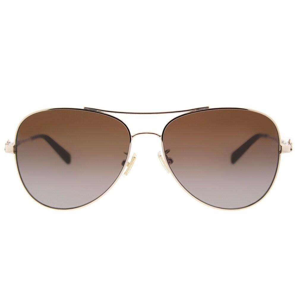 aafae3e3254 ... where to buy shop coach aviator hc 7074 9310t5 womens light gold frame  brown gradient polarized