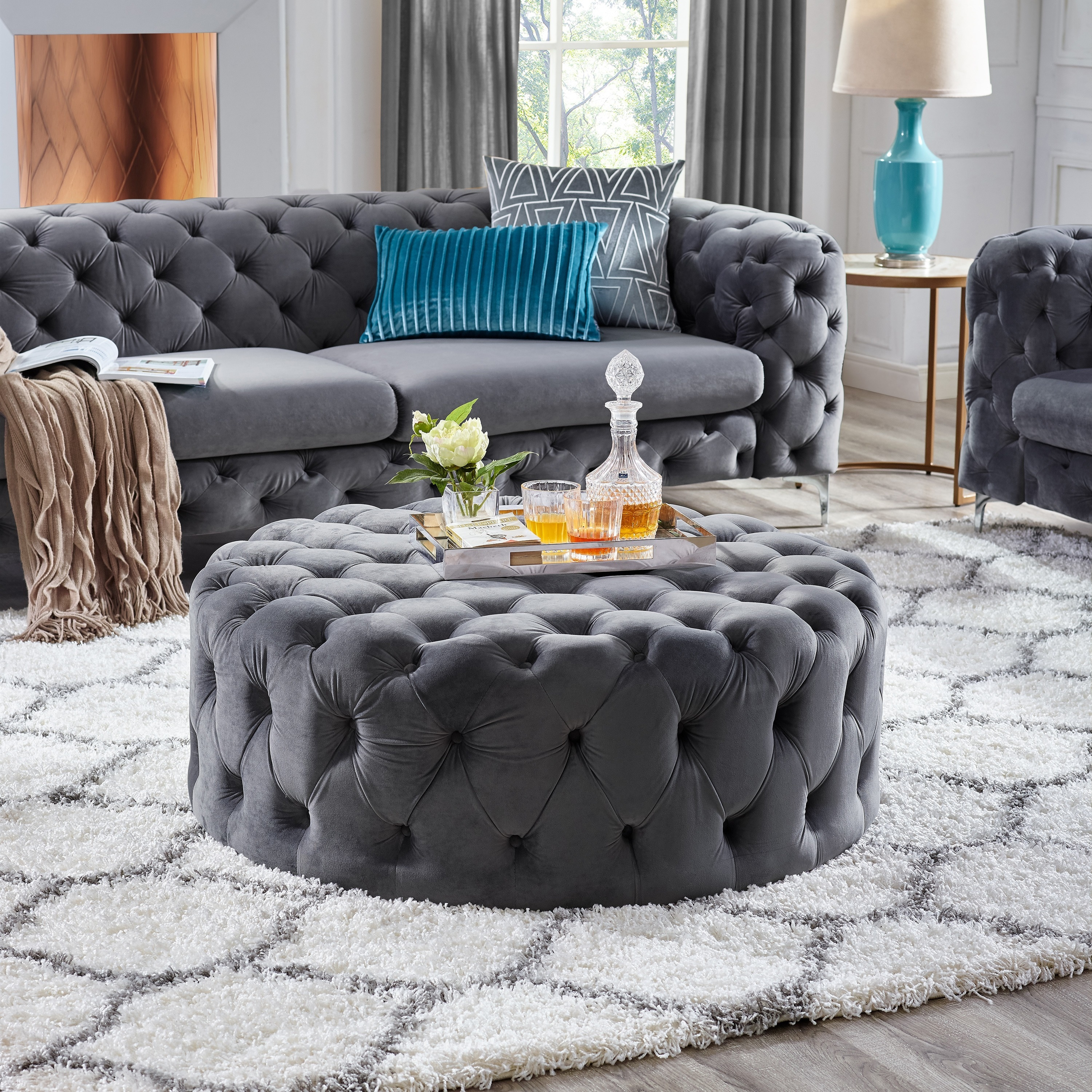 Shop corvus tufted velvet round ottoman with casters free shipping today overstock com 19755828